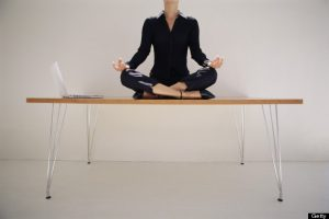 Woman meditating on desk